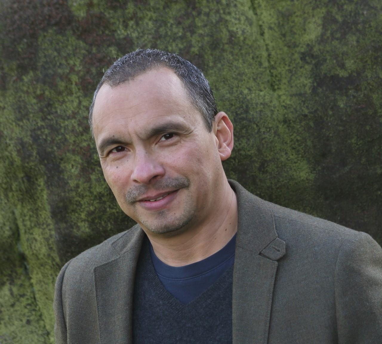 Poet Ian wears a suit