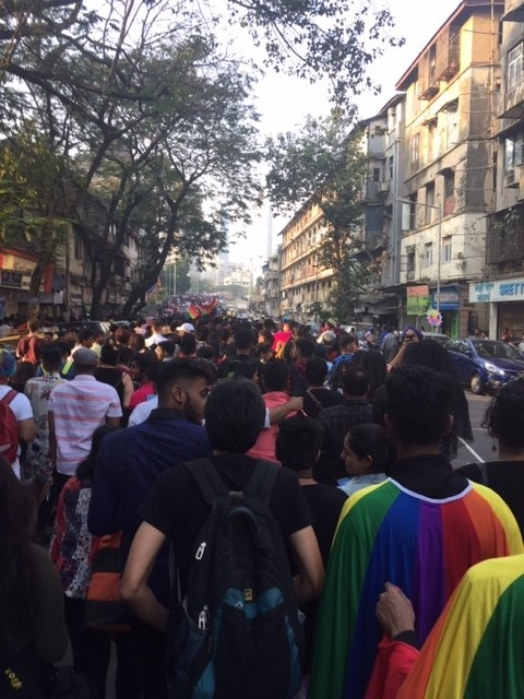 Marchers at Mumbai Pride pack into a busy street