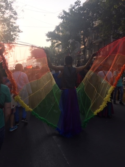 A marcher at Mumbai Pride wears a rainbow butterfly cape